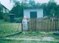 Anna Kršková at the place where the family house in Hynčice nad Moravou stood
