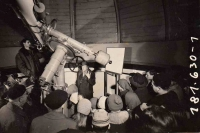 Tomáš Pertile (on the left above behind the observatory telescope) while observing a partial solar eclipse in the public observatory, Ostrava, 1961