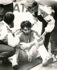 Handball World Cup in Czechoslovakia. Michal Barda is waking from unconsciousness, he was hit in his face by a French player, Philippe Gardent. 1990