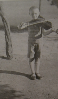 Playing violin in 1930s