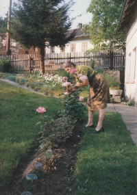 In front of her parents' house in Rousinov, about 1997
