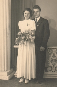 With her future husband at a friend's wedding as a bridesmaid, 1952