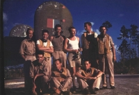 Evening at the Windsor Field base in Nassau. Standing, from the left: Karel Truxa, Ladislav Snídal, Josef Klesnil, Jan Irving (wearing a white tank top), Ilja Hrušák, an unknown man, probably British. Sitting, from the left: Karel Spitzkopf, Oskar Krebs, unknown Englishman