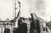 The banner bearer is Viktor Kropš, armourer of the No 311 (Czechoslovak) Squadron RAF. His life would be worth a book as well, especially its dramatic turns after 1948. His squadron was transferred to the Plzeň – Bory air base in 1946. During a military parade held in Plzen in 1945, Viktor met his future wife Jiřina. After the February 1948 Communist coup, they tried to escape the country with the help of a guide but on their way across the Domažlice forests, they were arrested by the border guard. Both Viktor and Jiřina threw themselves at the guardsmen, a fight ensued and Victor even wanted to use his handgun but they were overpowered. Jiřina was sentenced to one year in women's prison and Viktor was held in a long custody, subjected to cruel interrogations and he ended up in the labour camp in the uranium mines of Jáchymov, which permanently damaged his health. Jan helped this family in the hardest times as much as he could and the friendship hardened to almost family bond. When Viktor died only a few years after his release from the health issues caused by imprisonment, Jak was asked to lead his daughter Šárka to the altar as a sort of second father and Jiřina was a second mother to Iveta until her death in 2014.