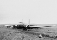 The only photograph from the ominous 11th September of 1946, when the Douglas DC-3/C-47A-80-DL (OK, cn 19535, sn 43-15069) of the Czechoslovak Airlines needed to perform an emergency landing at 1746. Captain Irving took off at 1205 from Amsterdam and there were 13 passengers and 5 crew on board. At 1546, the plane flew over the radar at the Praha Ruzyně airport and flew a hold above the clouds at 1700 metres. At 1625, in very inclement weather, the aircraft started to descend. After four unsuccesfull attempts at landing, the aircraft kept flying a hold around the airport. At the same time, a PanAm Lockheed Constellation with full fuel tanks was attempting to land so captain Irving's DC-3 had to keep waiting. The PanAm's Constellation decided to continue to Brussels. The DC-3, after running out of fuel, had to land at a field near Dobrovíz. Captain Irving and the wireless operator Šulc were injured but there were no casualties.