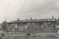 A unique photograph of one of the barracks of the German women's camp. Jan bought it after the war for the use of the Scout group whose member he had been before the war. Now he was their leader and continued the tradition. These barracks were located on a meadow in front of their house. Nowadays, there are two blocks of flats and two family houses whose construction buried an undeground air-raid shelter which could be entered well into the 1990's.
