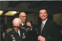The VIP guests included Jindra Polák, the director of Nebeští jezdci [Riders in the Sky, a 1968 movie].  and those airmen who remembered Ant in person. At the end of the book, there are their personal reminiscences and portrait photographs. Here, from the left: colonel JUDr. Lubomír Úlehla, colonel Jaroslav Hofrichter and Petr Jirmus. He is looking towards the stage where I'm probably talking to the microphone at the moment.