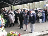 Memorial ceremony in Sagan. From the left, Karel Bryks, representing colonel Josef Briks, a tough boy with a sensitive soul who would escape from many a war prison camp, whose health was ruined by the Communist regime and forced labour in the Jáchymov uranium mines. WHat was the last straw that broke his heart was a ban on corresponding with his beloved English wife. Iveta Irvingová is representing V. Bufka and Václav Toman, the head of the Jan R. Irving Airforce History Club in Plzeň. He chose to join the party when Ivanka Škarvadová politely chose not to go to the strong rain and cold weather and remained in the VIP tent.