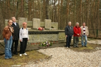 Sagan - after having lit a candle for each member of the delegation and having laid the bouquet, this photograph was taken. At the left, the family members of the deceased imprisoned airmen, Iveta Irvingová, Josef Bryks a Mgr. Ivana Škarvadová. On the right, historian and an expert on the Sagan events and the POW camp system, Vladislav Severin, who also researches the Czechoslovak paratrooper groups operating in the eastern part of Czech Republic. Next to him (middle of the photograph), standing, lieutenant colonel Ing. Jan Čelechovský, a former army pilot and one of the designated drivers of the group and next to him to the right, nephew of two RAF airmen (Vít Angetter and Albín Naswetter), Radovan Stýblo. The others humbly stood aside.