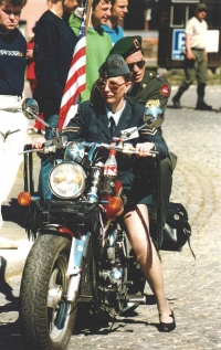 Here, Iveta's heritage shows in full - as a part  convoy of jeeps which followed the demarcation line, with a colleague from the U. S. army who sat all the way long behind her and with the U. S. flag, they were the last in the convoy. Stříbro, 2003