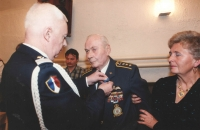 Colonel Irving was awarded the National Order of Merit [Ordre national du Mérite], in the grade of Knight, by the French military attaché, in May 1995 in the Legie Hotel in Prague. Colonel suffered from ill health, having been through two major surgeries including a heart bypass. The wounds caused by surgical incisions on his chest were healing badly and caused major pains so his caring wife Blanka had to support him.