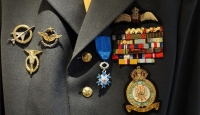 A close-up of the beautiful blue order on the uniform.