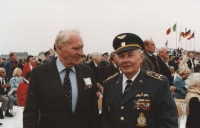 The photograph shows colonel Josef Šnajdr (United Kingdom), one of the former commanders of the No. 311. Squadron, in a lively debate with colonel Irving. He was a strict but fair commander who was respected by everyone. Now, after that many years, they chatted like old friend regardless of the former rank.