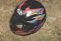 """""""My helmet mostly survived but the passenger's one is irrepairably destructed and I keep it in my cottage a permanent reminder that shouts in the space, whenever someone comes, that something good happen for a change and the bad go away."""""""