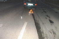 """""""The impact came many meters before the car came to a final halt. The driver did not pay attention, he chatted with his friends in the car and looked wherever, just not at the road. The long and prominent skid marks flanked by a line of fluid coming out of the punctured cooler, are shown on this photograph."""""""