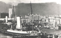 An unused postcard kept as a souvenir - the fishing port in Cape Town