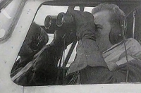 """Jan Irving in cockpit of """"his"""" Liberator during a guard"""