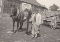 His dad at a farm carriage