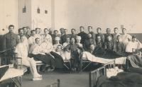 Antonín Špika in the army hospital, with both arms bandaged.