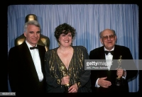 Karel Černý sand Patrizia von Brandenstein receive Oscar award in production design for Amadeus from Steve Martin on March 25, 1985