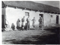 Glajch in front of his father's carpentry workshop in Straklov
