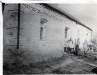 Glajch in front of his house in Straklov