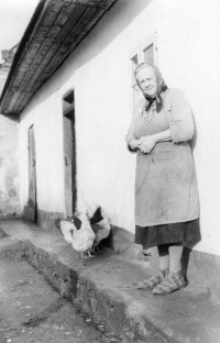 Vladimír´s grandmother Marie Brožová in front of adobe cottage in Litohlavy, mid 1970s