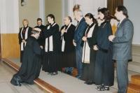 Her husband Miloš Košíček is being ordained as a priest; 1998
