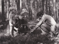 Sergej Machonin with his friend and children at work in a forest in Vysočina