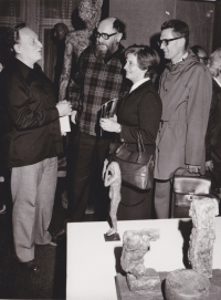 Sergej Machonin debating with his friends on an exhibition of his friend, sculptor Olbram Zoubek