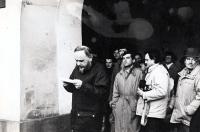 Pavel Bártek (v baloňáku za řečníkem Aloisem Válkem) na generální stávce v Novém Jičíně / 27. listopad 1989 Pavel Bártek (in a trench coat behind Alois Válek, the speaker) during the General Strike in Nový Jičín / November 27th 1989