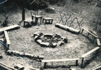 Campfire and seating in the Koloděje summer camp. 1970
