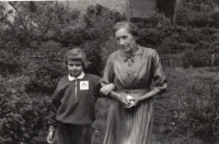 Her grandmother with Dana (with the Young firefighter badge) in  the garden in Hleďsebe, around 1960