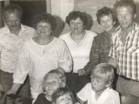 Emilia Sasinova, second from the right in the upper row with sisters and mother, lower row on the left