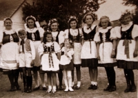 May 1945 - girls in folk costumes welcoming the liberators (Marie Veselá is the one in the middle).