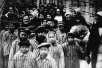 Slovak painter Ľudovít Feld (front left) with his children, Auschwitz, 1945