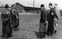 Štefan Gabčan (in an officer's cap) as the commander of the concentration camp, Nováky, 1944