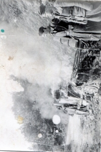 truck in flames after aerial bombing of a column carrying Slovak soldiers on the Italian front