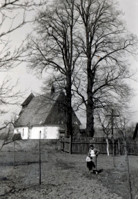 Karel Pexidr with his mother in front of the St. Ambrose church in Vícov; 1935