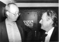 Petr Brod, the first permanent correspondent of Free Europe in Prague, looks down at his boss, the director of the Czechoslovak editorial office in Munich, Pavel Pecháček, about 1991
