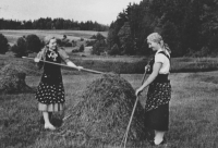 Mother Marie (on the right) during haymaking on the meadow near the mill in Sázava, 1937