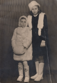 With a sister in a fur coat of domestic rabbits