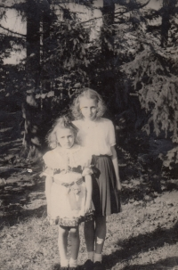 With sister wearing costume at liberation celebration in 1945