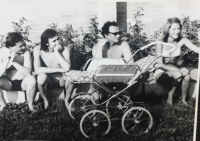 in the swimming pool with his wife and Peter Hanzely