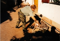 Iva Valdmanova examines a corpse, a mission in Bosnia, Knin, 1995