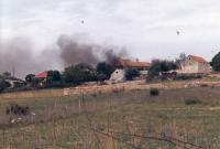 A burnt village in Bosnia, 1995