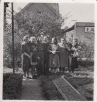 Sewing flags in Hermelínská street, May 9, 1945
