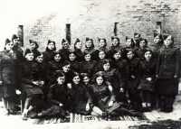 Volhynian graduates of the nursing course in Kyiv, August - October 1944. Sitting on the ground, from the left: Helena Průšová-Prokešová, Stanislava Zolerová-Havlíčková, Alla Karfiková-Boroličová, unknown. Source: Československé ženy [Czechoslovak Women]