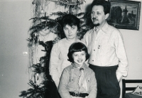 With her parents, Zdeňka and Přemysl Mucha, Christmas 1968