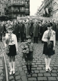 Her brother, Antonín Mucha - a Boy Scout among Pioneers, with flowers for Alexander Dubček, May 1st, 1968